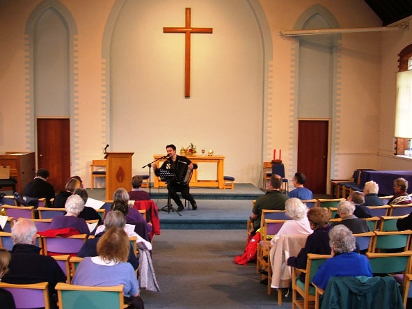 Leatherhead Methodist Church, Church Road, KT22 8AY, interior, with accordion player,
